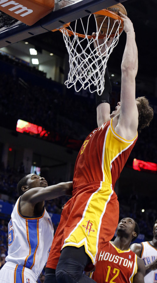 Photo - Houston's Omer Asik (3) dunks over Oklahoma City's Kevin Durant (35) during Game 5  in the first round of the NBA playoffs between the Oklahoma City Thunder and the Houston Rockets at Chesapeake Energy Arena in Oklahoma City, Wednesday, May 1, 2013. Photo by Sarah Phipps, The Oklahoman