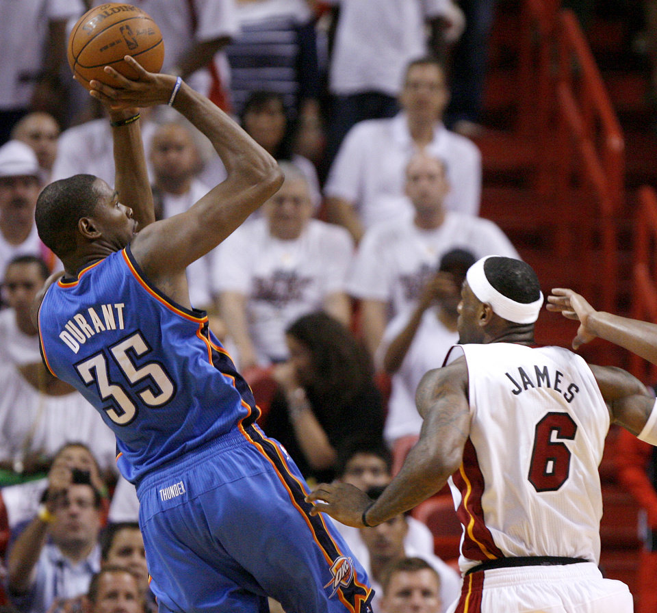 Photo - Oklahoma City's Kevin Durant (35) shoots the ball beside Miami's LeBron James (6) during Game 4 of the NBA Finals between the Oklahoma City Thunder and the Miami Heat at American Airlines Arena, Tuesday, June 19, 2012. Photo by Bryan Terry, The Oklahoman