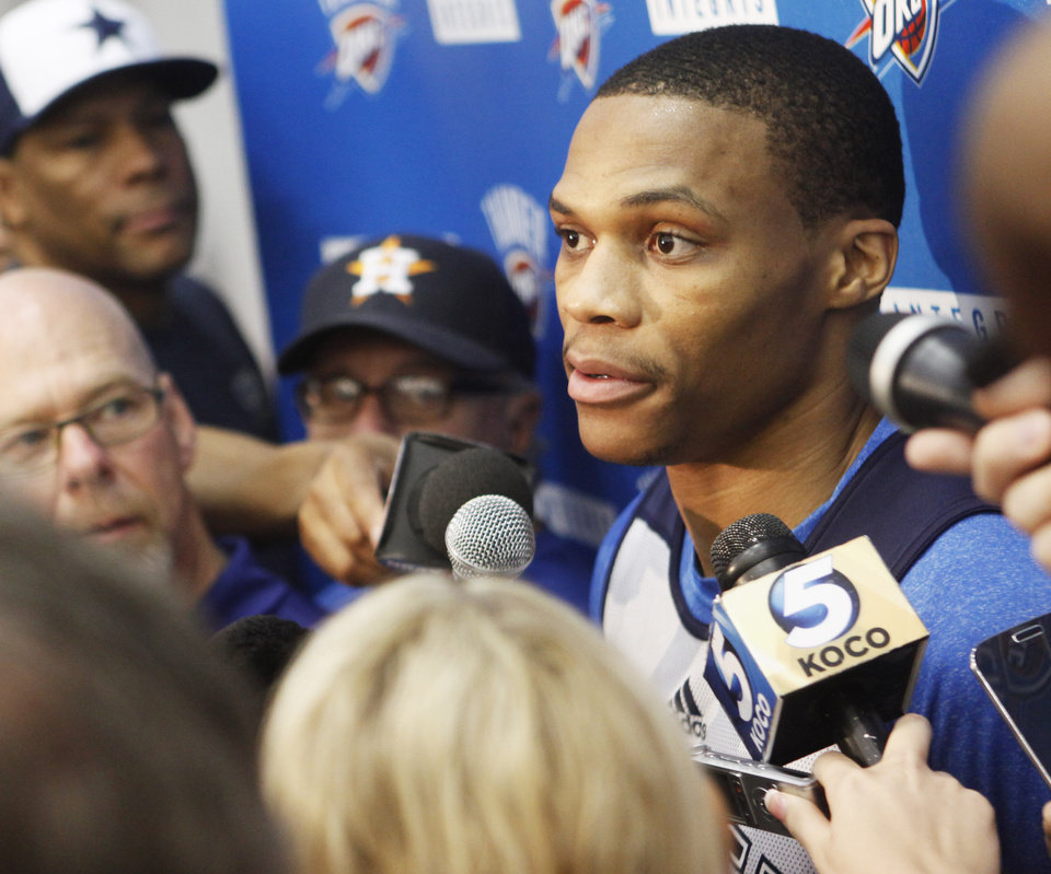 Photo - Thunder guard Russell Westbrook speaks to the media after practice at the Thunder Practice Facility in Oklahoma City on Monday, April 26, 2014. PHOTO BY KT KING, The Oklahoman