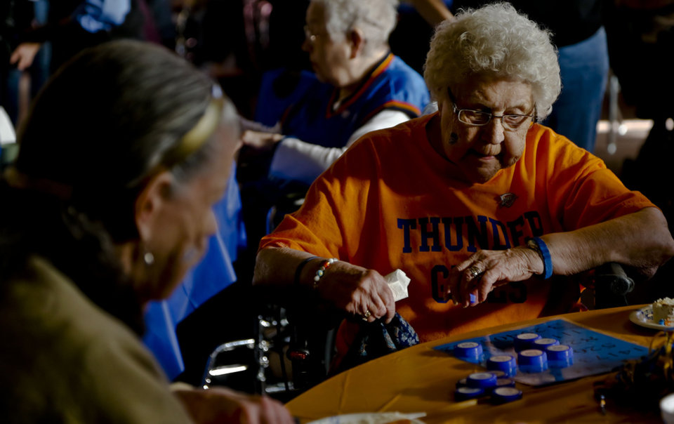Lois Olson keeps a close eye on her bingo card  at Ranchwood Nursing Home in Yukon, during the Oklahoma City Thunder's 1,000th community appearance.   Photo by Chris Landsberger, The Oklahoman <strong>CHRIS LANDSBERGER - CHRIS LANDSBERGER</strong>