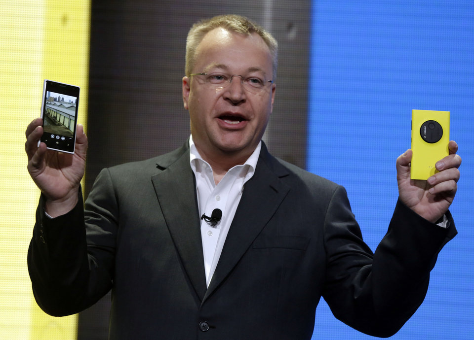 Photo - Nokia CEO Stephen Elop shows his company's Nokia Lumia 1020, in New York,  Thursday, July 11, 2013. The Nokia Lumia 1020, with a 41-megapixel camera, records more detail than other camera phones and even tops point-and-shoot cameras. (AP Photo/Richard Drew)