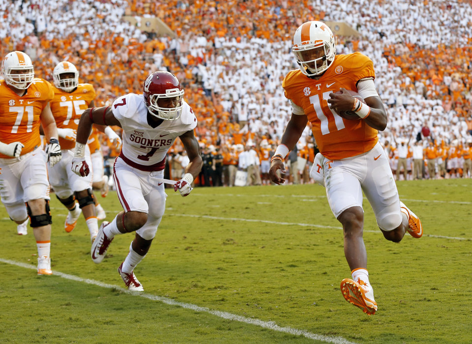 Photo - Tennessee's Joshua Dobbs (11) carries the ball for a touchdown past Oklahoma's Jordan Thomas (7) in the second quarter during the college football game between the Oklahoma Sooners (OU) and the Tennessee Volunteers at Neyland Stadium in Knoxville, Tennessee, Saturday, Sept. 12, 2015. Photo by Nate Billings, The Oklahoman