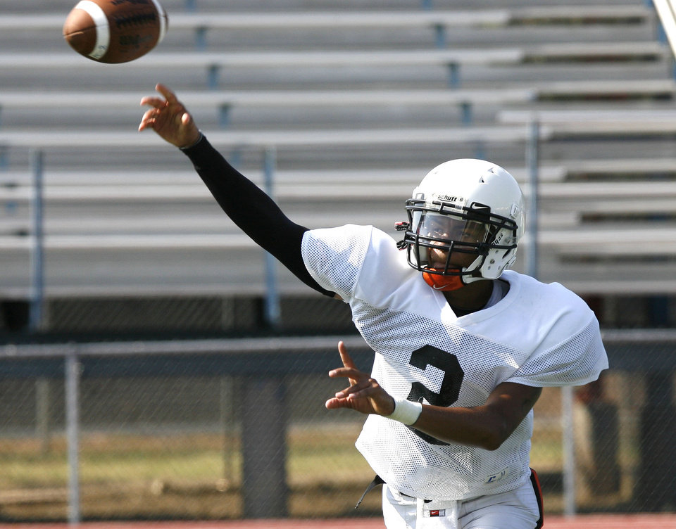 Photo - Putnam City quarterback Devin White passes the ball during a 2011 practice.  Photo By Paul Hellstern, The Oklahoman Archives
