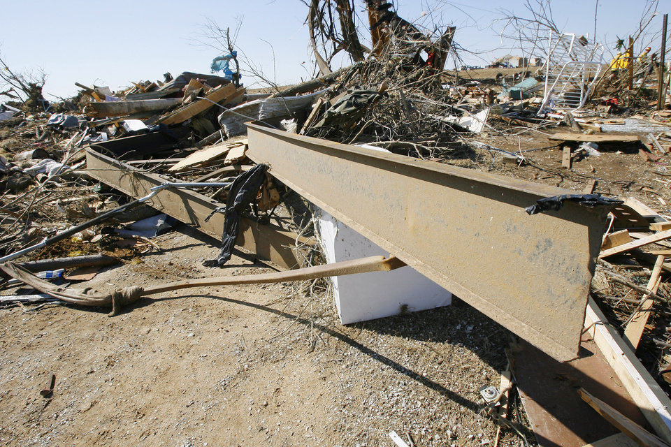 Photo - Bent and twisted rails from the base of a mobile home where unaccounted persons are on Brock Road in Lone Grove, Wednesday, Feb. 11, 2009. BY PAUL B. SOUTHERLAND, THE OKLAHOMAN