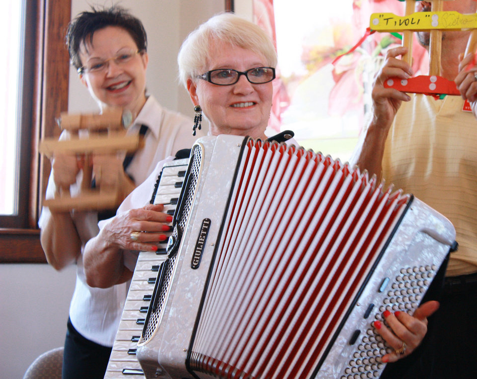 Photo - Accordionist Barbara Duer performs, backed up by Maggie Abel. The two were among about 20 performers who participated in an accordion extravaganza at the Santa Fe Depot, sponsored by the Oklahoma Accordion Club. PHOTO BY LYNETTE LOBBAN, FOR THE OKLAHOMAN