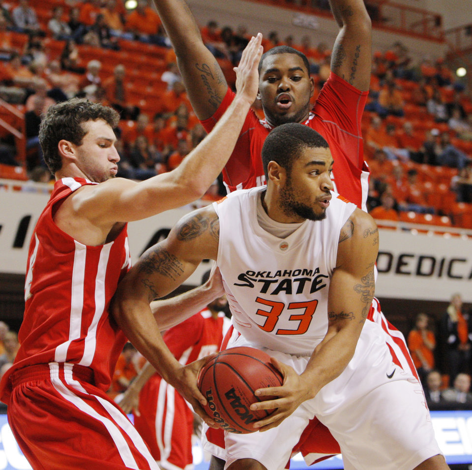 OSU\'s Marshall Moses (33) looks to pass the ball away from Ben Martin (4), left, and Fred Hunter (20), top, of Nicholls State in the first half during the men\'s college basketball game between Nicholls State University and Oklahoma State University at Gallagher-Iba Arena in Stillwater, Okla., Saturday, Nov. 21, 2010. Photo by Nate Billings, The Oklahoman