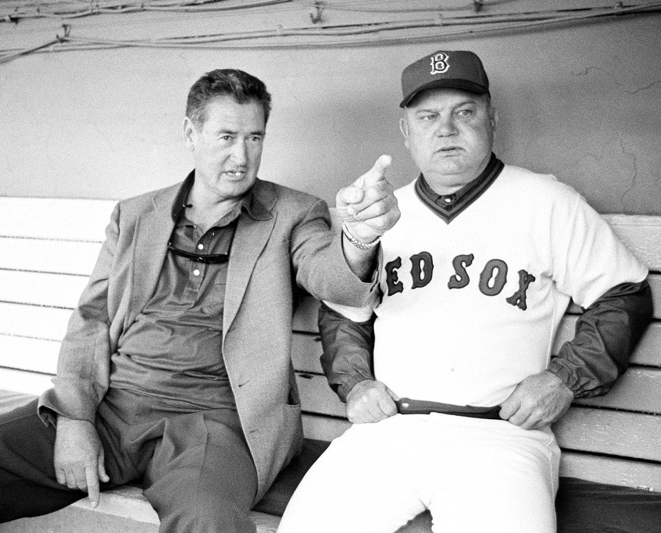 Photo - FILE - In this Sept. 30, 1978 file photo, former Boston Red Sox slugger Ted Williams, left, points as he chats with Red Sox manager Don Zimmer about players on the field, prior to game with the Toronto Blue Jays at Fenway Park in Boston. Don Zimmer, a popular fixture in professional baseball for 66 years as a manager, player, coach and executive, has died. He was 83. (AP Photo/Dave Tenenbaum, File)