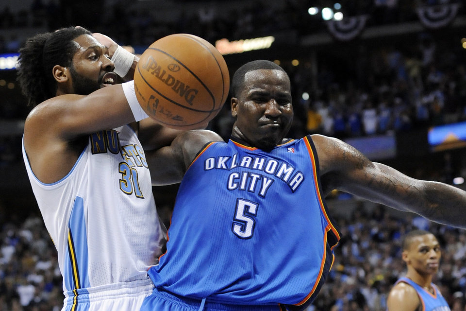 Photo - Denver Nuggets center Nene (31) from Brazil and Oklahoma City Thunder center Kendrick Perkins (5) tangle during the second half in game 4 of a first-round NBA basketball playoff series Monday, April 25, 2011, in Denver. Denver beat Oklahoma 104-101. Oklahoma City leads the series 3-1. (AP Photo/Jack Dempsey)