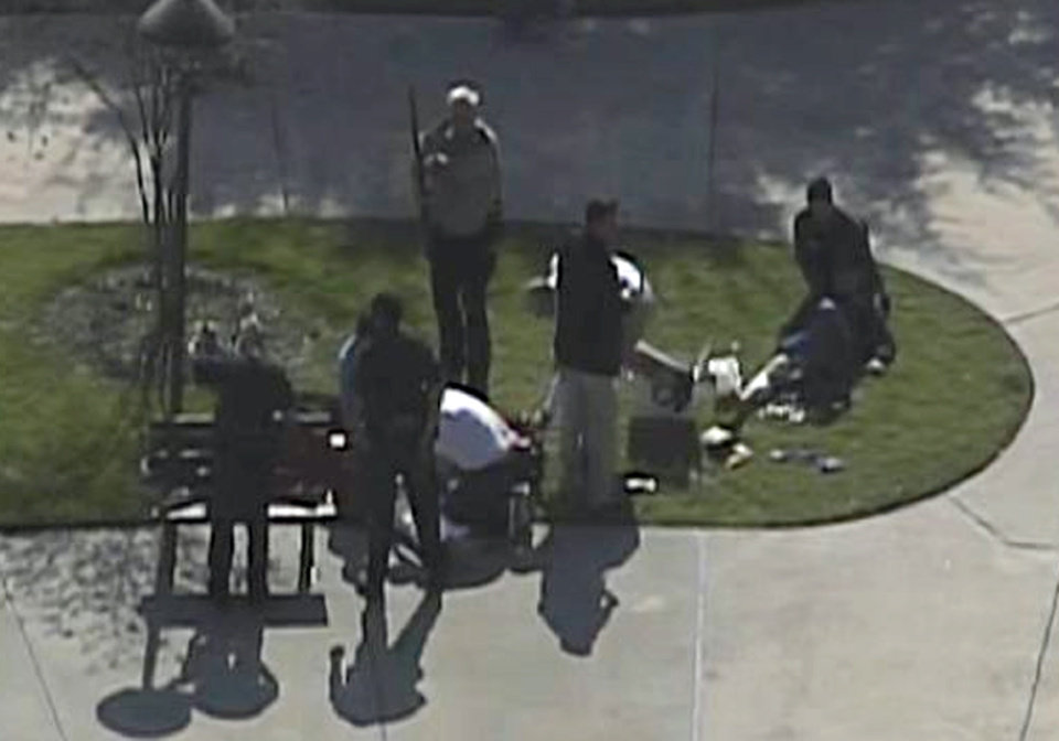 Photo - This frame grab provided by KPRC Houston shows the scene at Lone Star College Tuesday, Jan. 22, 2013 as police and emergency personnel work.  A shooting at the Texas community college campus wounded at least two people Tuesday and sent students fleeing for safety officials said.  (AP Photo/Courtesy KPRC TV)