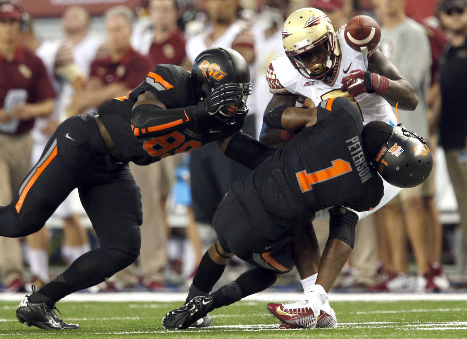 Photo - Oklahoma State's Kevin Peterson (1) and Sam Wren (89) tackle Florida State's Karlos Williams (9) during the college football game between Oklahoma State University (OSU) and Florida State University (FSU) at the AdvoCare Cowboys Classic at At&T Stadium in Arlington, Texas,  Saturday, Aug. 30, 2014. Photo by Sarah Phipps, The Oklahoman