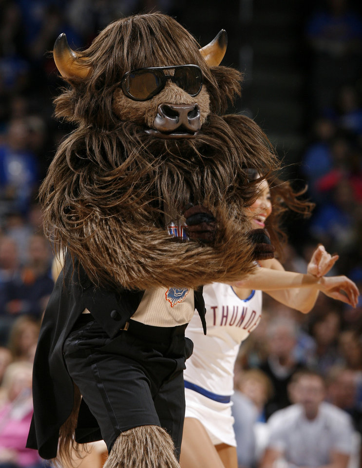 Photo - Rumble the bison dances to Gangnam Style during an NBA basketball game between the Oklahoma City Thunder and the Golden State Warriors at Chesapeake Energy Arena in Oklahoma City, Sunday, Nov. 18, 2012.  Photo by Garett Fisbeck, The Oklahoman