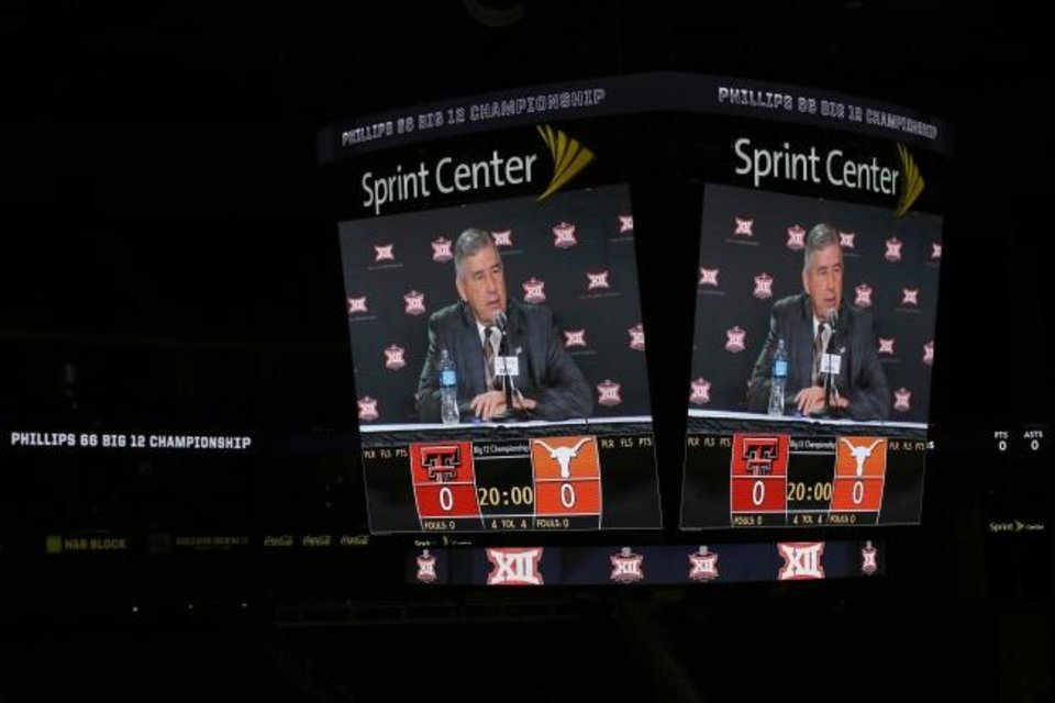 Photo -  Big 12 commissioner Bob Bowlsby is seen on the big screen in an empty Sprint Center on March 12 after the cancellation of the conference basketball tournaments. [AP Photo/Charlie Riedel]