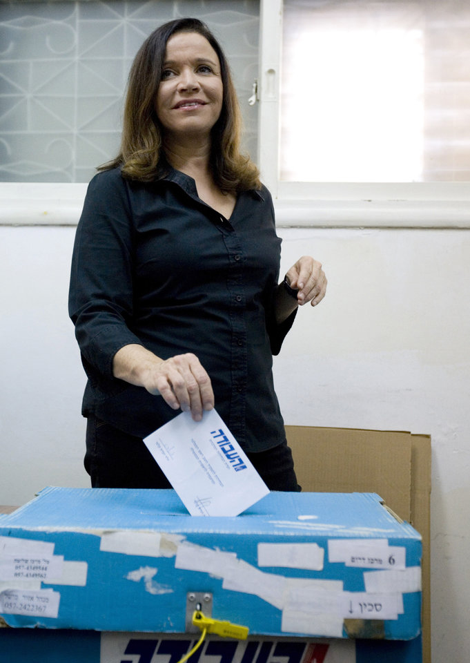 FILE- In this Sept. 12, 2011 file photo, Israel's Labor party candidate and former journalist Shelly Yachimovich casts her vote during her party's primary elections in Tel Aviv, Israel.  Israel's Labor Party will be fielding a large number of former journalists in the country's upcoming parliamentary elections. Six former journalists, including party chairwoman Shelly Yachimovich, figure among the top 25 labor candidates who will be running in the Jan. 22 parliamentary race. The party held its primary on Thursday and released the list of candidates on Friday.(AP Photo/Ariel Schalit, File)