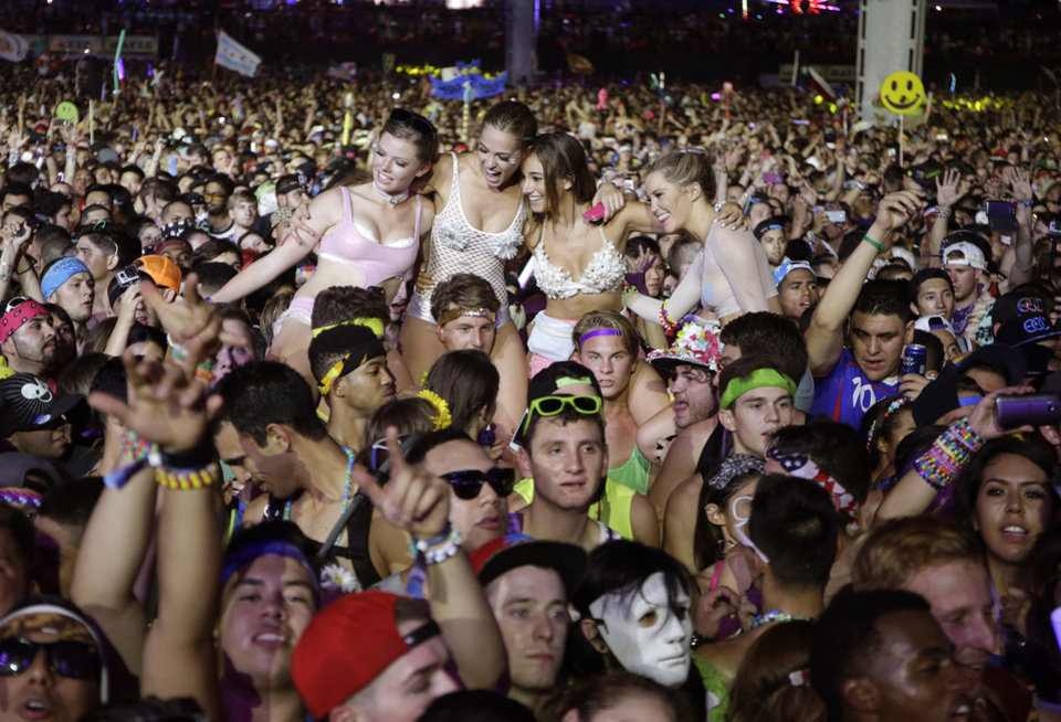 Photo - Carnival goers listen to music by Krewella at the Electric Daisy Carnival, Saturday, June 21, 2014, in Las Vegas. (AP Photo/John Locher)