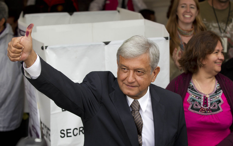 Photo -   Mexican presidential candidate Andres Manuel Lopez Obrador of the Democratic Revolution Party (PRD) shows his election ink-stained thumb after casting his vote at a polling station in Mexico City, Sunday, July 1, 2012. Mexico's more than 79 million voters head to the polls Sunday to elect a president, who serves one six-year term, as well as 500 congressional deputies and 128 senators. (AP Photo/Eduardo Verdugo)