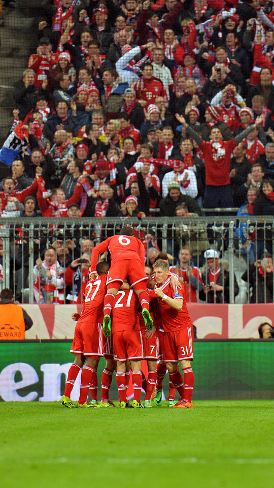 Photo - Bayern's players celebrate after scoring during the Champions League round of the last 16 second leg soccer match between FC Bayern Munich and Arsenal FC in Munich, Germany, on Tuesday, March 11. 2014. (AP Photo/Kerstin Joensson)