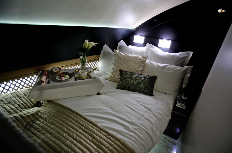 """Photo - The 125-square-foot (11.61-square-meter) area that includes a """"living room"""" partitioned off from the first-class aisle, leather seating, a chilled minibar and a 32-inch flat-screen TV, at a training facility in Abu Dhabi, United Arab Emirates, Sunday, May 4, 2014. Etihad Airways, a fast-growing Mideast carrier, laid out plans Sunday to offer passengers who find first-class seats a bit too tight a miniature suite featuring a closed-off bedroom, private bathroom and a dedicated butler. (AP Photo/Kamran Jebreili)"""