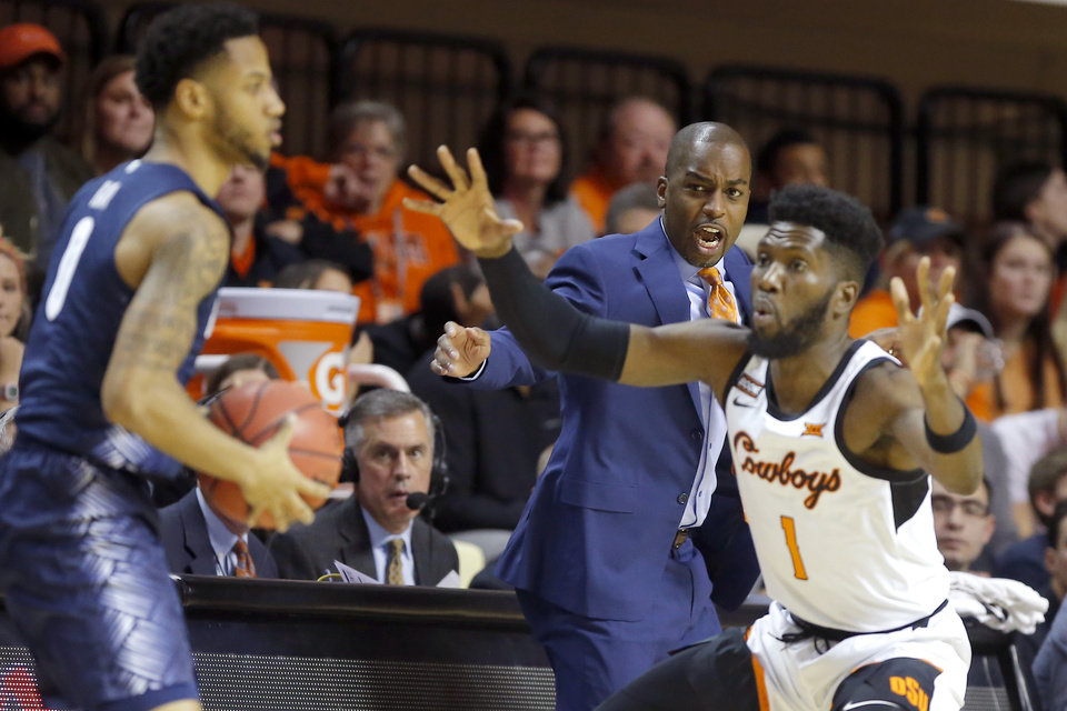 Photo - Oklahoma State coach Mike Boynton shouts during a college basketball game between the Oklahoma State University Cowboys (OSU) and the Georgetown Hoyas at Gallagher-Iba Arena in Stillwater, Okla., Wednesday, Dec. 4, 2019. Georgetown won 84-71. [Bryan Terry/The Oklahoman]