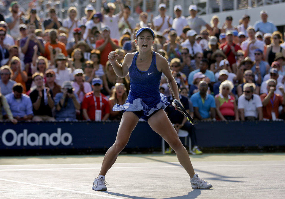 Photo - Catherine Bellis, of the United States, reacts after a point against Dominika Cibulkova, of Slovakia, during the first round of the 2014 U.S. Open tennis tournament, Tuesday, Aug. 26, 2014, in New York. (AP Photo/Darron Cummings)