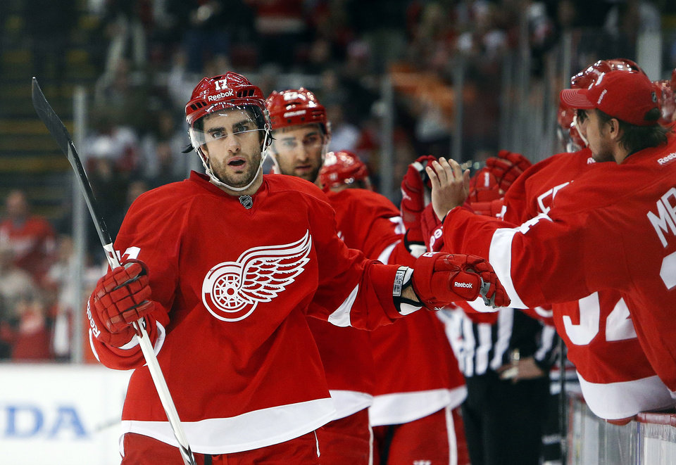 Photo - Detroit Red Wings wing Patrick Eaves celebrates a goal against Chicago Blackhawks goalie Corey Crawford in the first period of an NHL hockey game Wednesday, Jan. 22, 2014, in Detroit. (AP Photo/Paul Sancya)