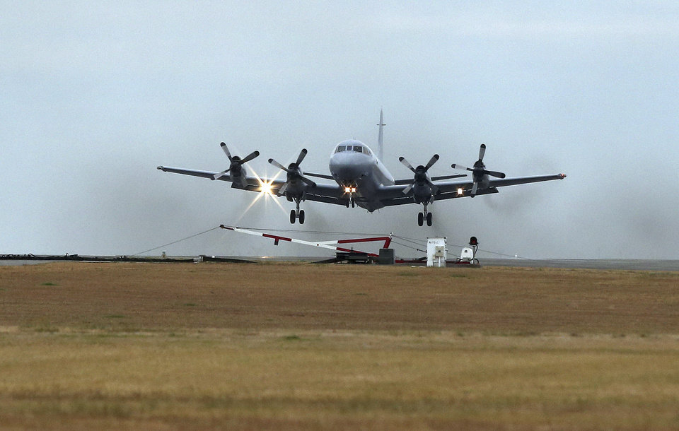 Photo - A Royal Australia Air Force AP-3C Orion takes off from RAAF Base Pearce in Perth, Australia to resume the search for missing Malaysia Airlines Flight MH370 in the southern Indian Ocean, Wednesday, March 26, 2014. As frustration was setting in, calmer seas returned Wednesday and the search for the remains of Flight 370 began anew in remote waters of the Indian Ocean off western Australia. (AP Photo/Rob Griffith)