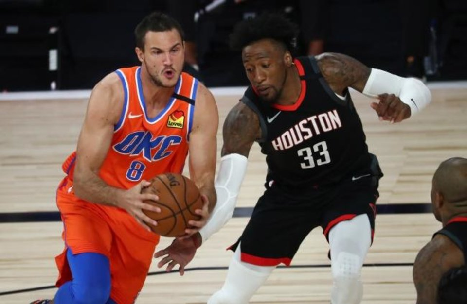 Photo -  Thunder forward Danilo Gallinari (8) scored a team-high 29 points Tuesday against Robert Covington (33) and the Rockets. [Kim Klement/USA TODAY Sports]