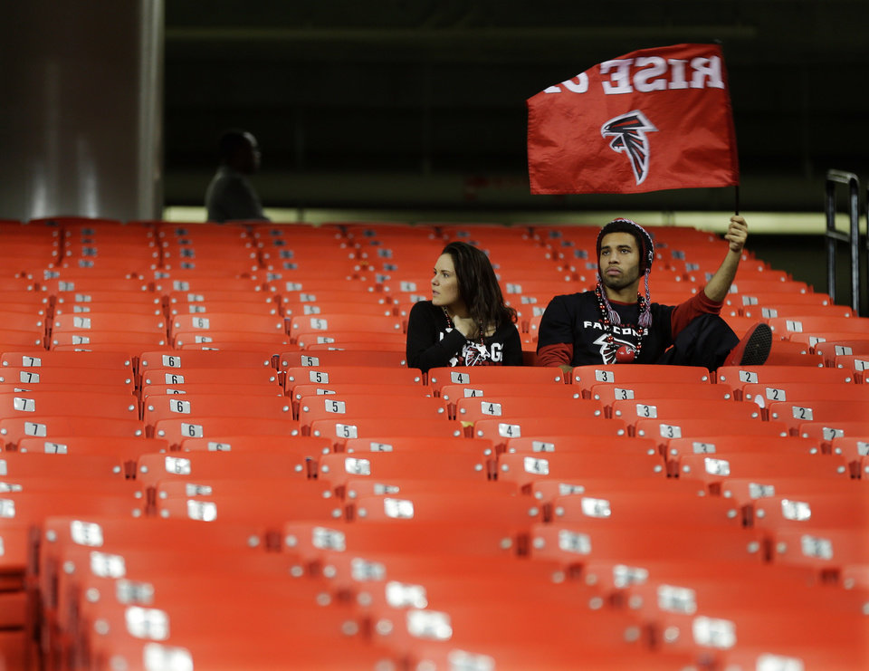 Atlanta Falcons fans sit in the stands after the NFL football NFC Championship game against the Atlanta Falcons Sunday, Jan. 20, 2013, in Atlanta. The 49ers won 28-24 to advance to Super Bowl XLVII. (AP Photo/David Goldman)