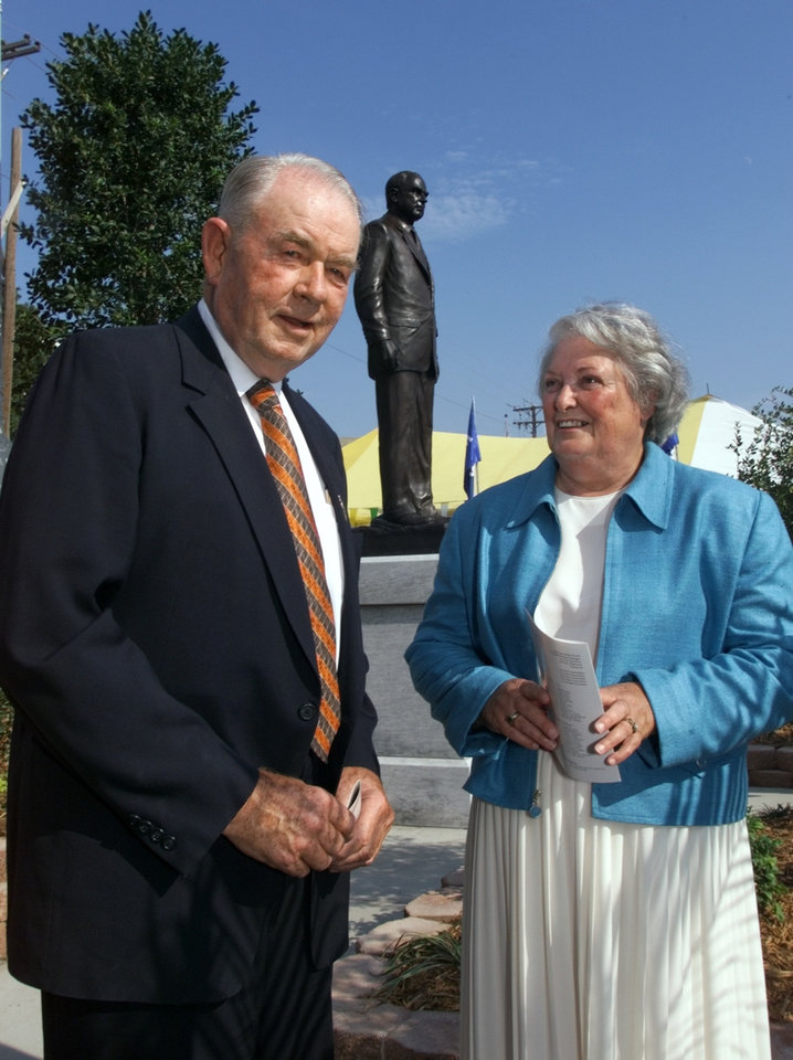 Former Gov. Henry Bellmon and Shirley Bellmon attend the opening ceremonies of the State Fair of Oklahoma at which the statue of the former governor (background) was unveiled.