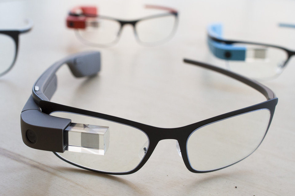 "The new Google Glass ""Bold"" prescription frames in ""shale"" color rests on a table at the Google Glass Basecamp space at Chelsea Market, Friday, Jan. 24, 2014, in New York. (AP Photo/John Minchillo)"