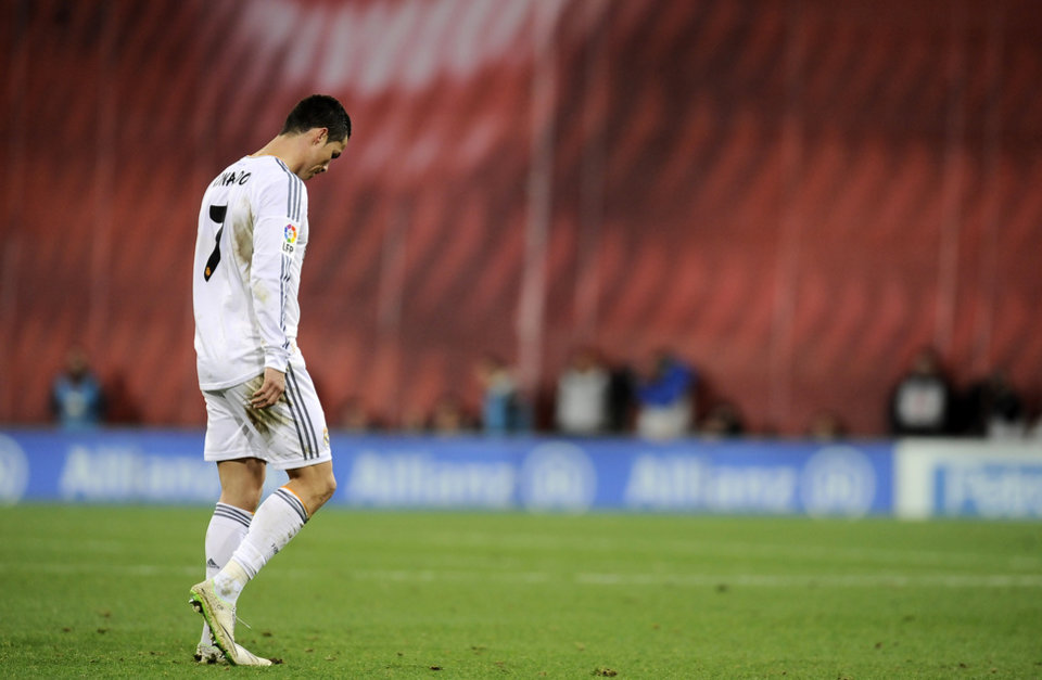 Photo - Real Madrid's Cristiano Ronaldo of Portugal, leaves the pitch after receiving a direct red card, during their Spanish League soccer match against Athletic Bilbao, at San Mames stadium in Bilbao, Spain, Sunday, Feb. 2, 2014.  (AP Photo/Alvaro Barrientos)