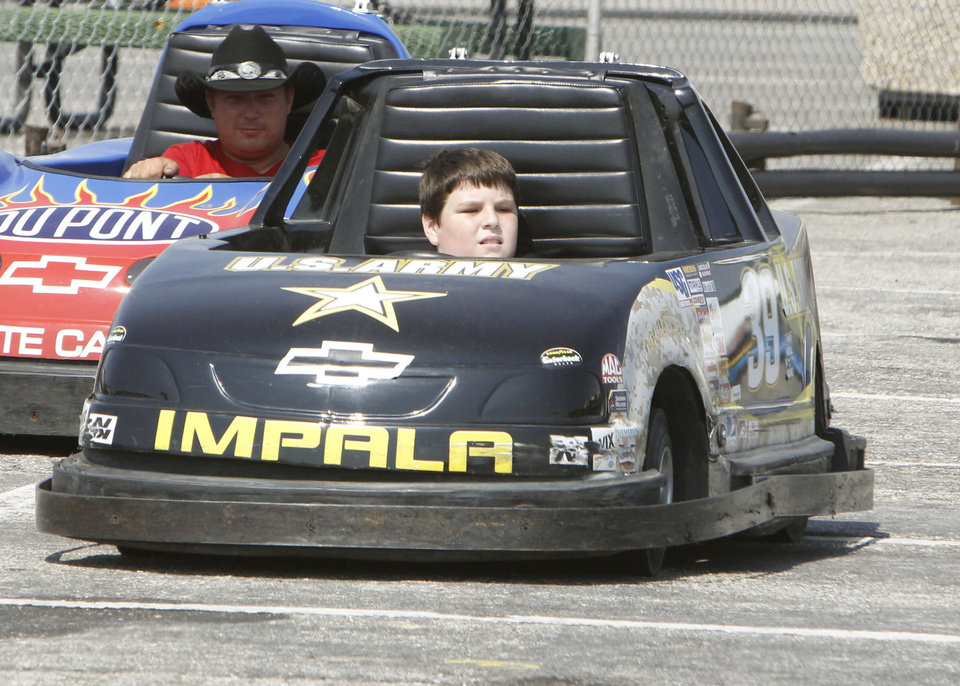 Ten year old Brennen Fisher drives a race car during the Oklahoma State Fair at State Fair Park in Oklahoma City, OK, Thursday, September 20, 2012,  By Paul Hellstern, The Oklahoman