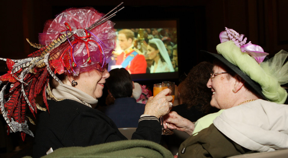 Photo - Bobbie Sinclair, left and Pat Cooper toast as they watch the royal wedding at the Palace Theatre in London, Ontario,  early Friday, April 29, 2011.  (AP Photo/The Canadian Press, Dave Chidley) ORG XMIT: DJC106