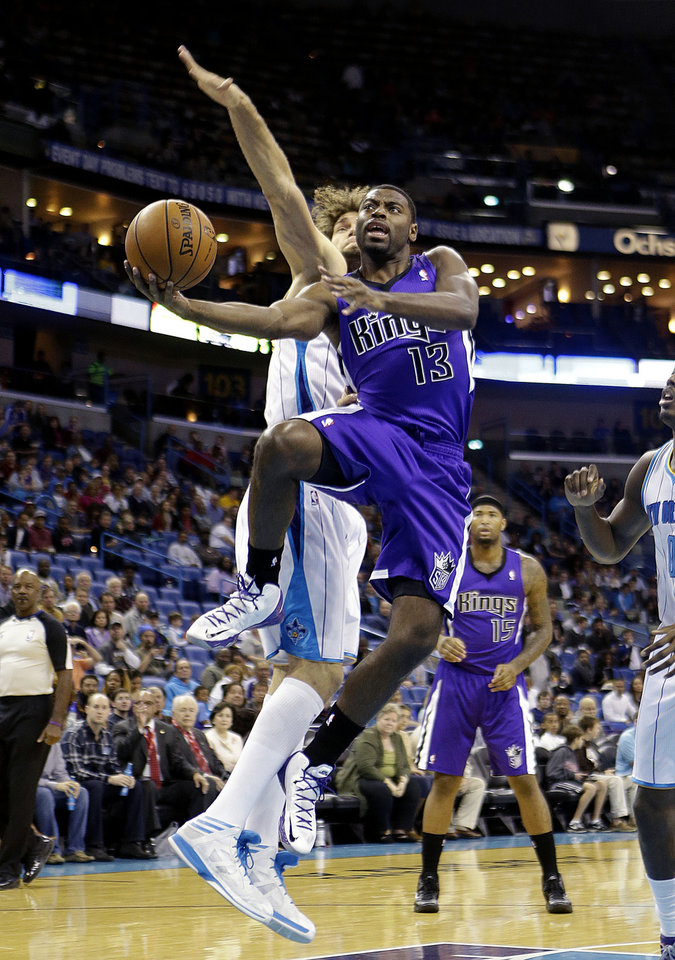 Sacramento Kings point guard Tyreke Evans (13) drives to the basket past New Orleans Hornets center Robin Lopez in the first half of an NBA basketball game in New Orleans, Sunday, Feb. 24, 2013. (AP Photo/Gerald Herbert)