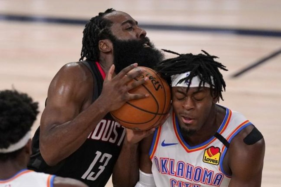 Photo -  Houston Rockets' James Harden (13) drives into Oklahoma City Thunder's Luguentz Dort (5), right, trying to get up court during the second half of an NBA first-round playoff basketball game in Lake Buena Vista, Fla., Wednesday, Sept. 2, 2020. (AP Photo/Mark J. Terrill)