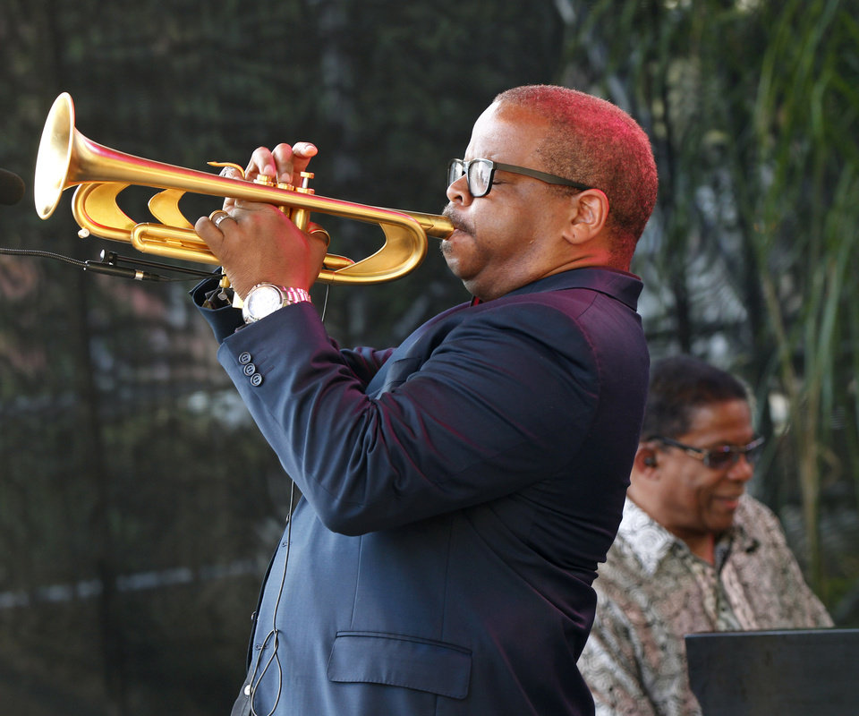 Photo -   CORRECTS SPELLING OF FIRST NAME TO TERENCE - Terence Blanchard, foreground, and Herbie Hancock perform at a sunrise concert marking International Jazz Day in New Orleans, Monday, April 30, 2012. The performance, at Congo Square near the French Quarter, is one of two in the United States that day; the other is in the evening in New York. Thousands of people across the globe are expected to participate in International Jazz Day, including events in Belgium, France, Brazil, Algeria and Russia. (AP Photo/Gerald Herbert)