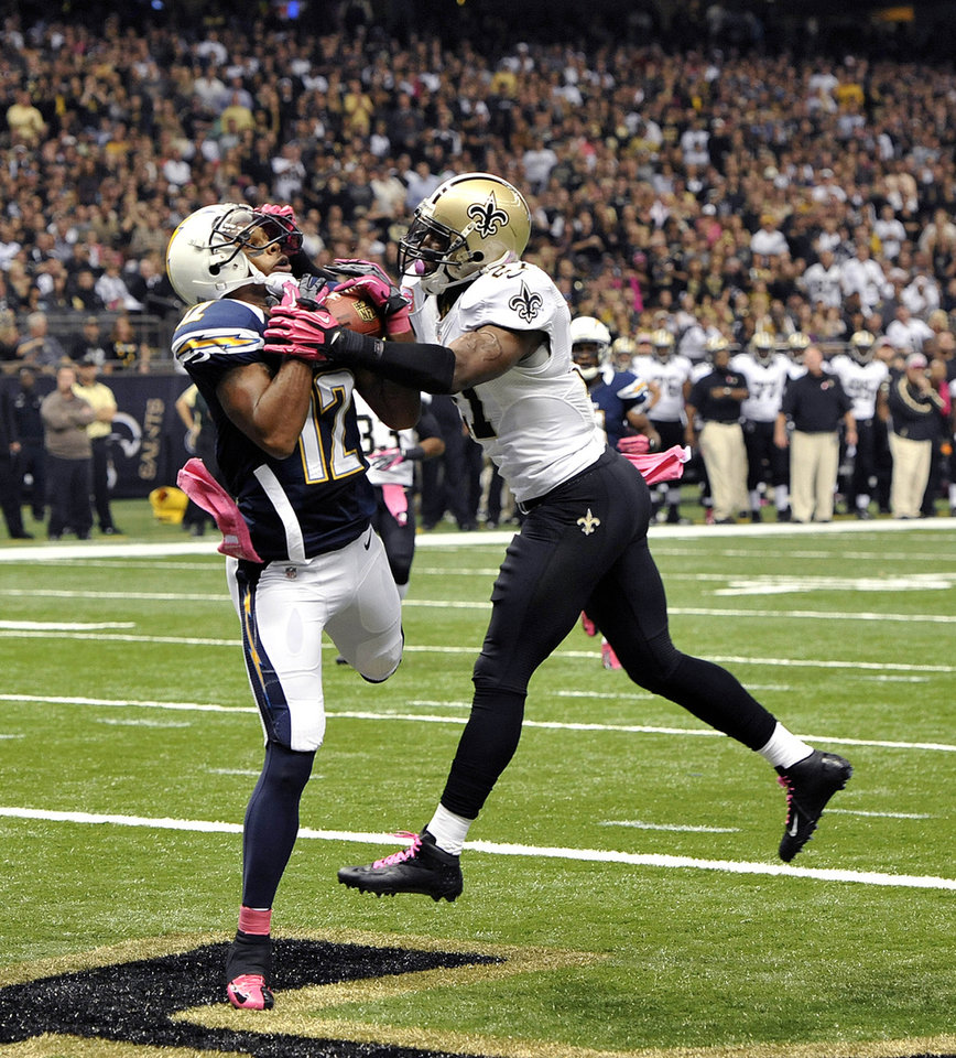 Photo -   San Diego Chargers wide receiver Robert Meachem (12) catches a touchdown pass over New Orleans Saints free safety Malcolm Jenkins (27) in the first half of an NFL football game at the Mercedes-Benz Superdome in New Orleans, Sunday, Oct. 7, 2012. (AP Photo/Bill Feig)
