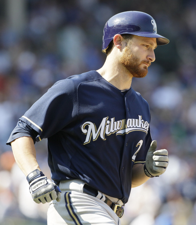 Photo -   Milwaukee Brewers' Jonathan Lucroy rounds the bases after hitting a grand slam during the third inning of a baseball game against the Chicago Cubs in Chicago, Thursday, Aug. 30, 2012. (AP Photo/Nam Y. Huh)