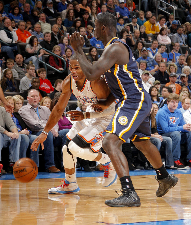 Photo - Oklahoma City's Russell Westbrook (0) tries to get around Indiana's Lance Stephenson (1) during the NBA game between the Indiana Pacers and the Oklahoma City Thunder at the Chesapeake Energy Arena   Sunday,Dec. 9, 2012. Photo by Sarah Phipps, The Oklahoman