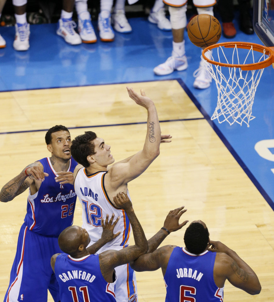 Photo - Steven Adams (12) watches a shot go to the rim during Game 5 of the Western Conference semifinals in the NBA playoffs between the Oklahoma City Thunder and the Los Angeles Clippers at Chesapeake Energy Arena in Oklahoma City,  Tuesday, May 13, 2014. Photo by Bryan Terry, The Oklahoman