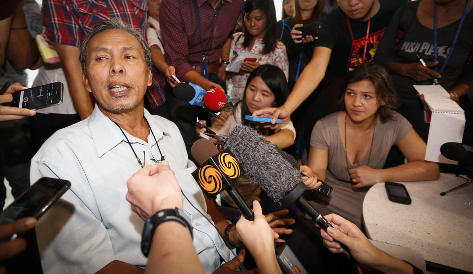 Photo - Selamat Omar, 60, father of one of the passengers aboard a missing Malaysia Airlines plane, speaks to the media at a hotel in Putrajaya, Malaysia, Thursday, March 20, 2014. Four military search planes were dispatched Thursday to try to determine whether two large objects bobbing in a remote part of the Indian Ocean were part of a possible debris field of the missing Malaysia Airlines flight. One of the objects spotted by satellite imagery had a dimension of 24 meters (almost 80 feet) and the other one was smaller. (AP Photo/Vincent Thian)