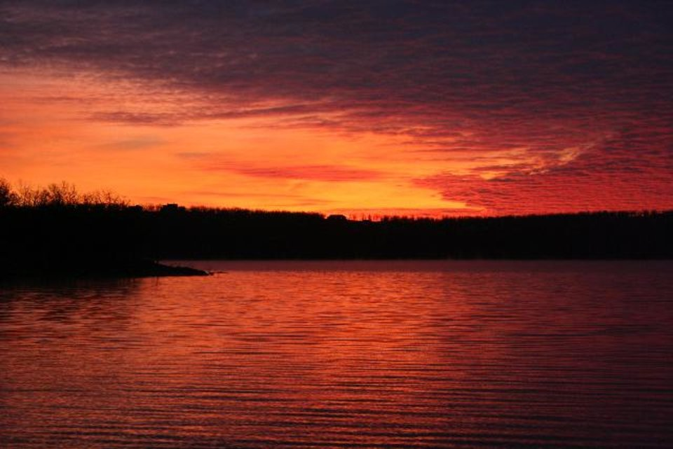 Photo -  Sunrise on Skiatook Lake. Photo by Alan McGuckin.