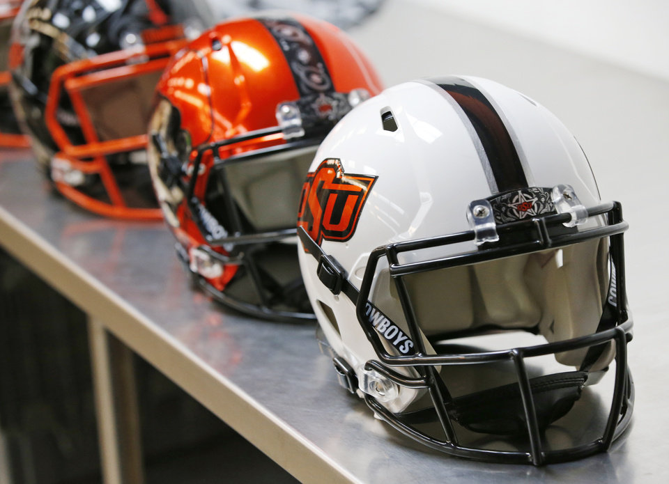 Photo - OSU football helmets in the Oklahoma State football equipment area at Boone Pickens Stadium in Stillwater, Okla., Wednesday, Aug. 1, 2018. Photo by Nate Billings, The Oklahoman