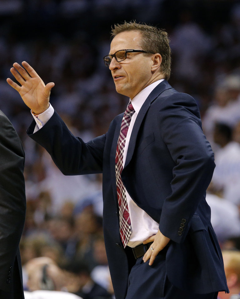 Photo - Oklahoma City coach Scott Brooks is called for a technical foul during Game 6 of the Western Conference Finals in the NBA playoffs between the Oklahoma City Thunder and the San Antonio Spurs at Chesapeake Energy Arena in Oklahoma City, Saturday, May 31, 2014. Photo by Bryan Terry, The Oklahoman