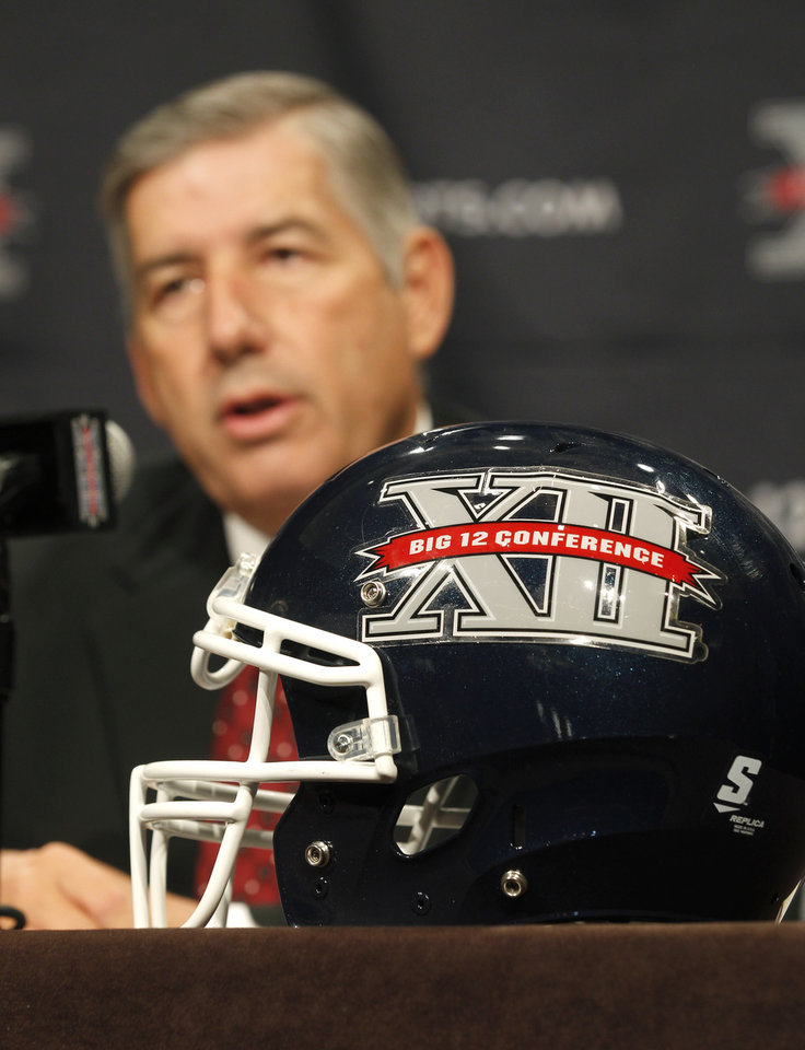 Big 12 Conference Commissioner Bob Bowlsby addresses the media at the beginning of the Big 12 Conference Football Media Days, Monday, July 22, 2013 in Dallas.  (AP Photo/Tim Sharp) ORG XMIT: TXTS102