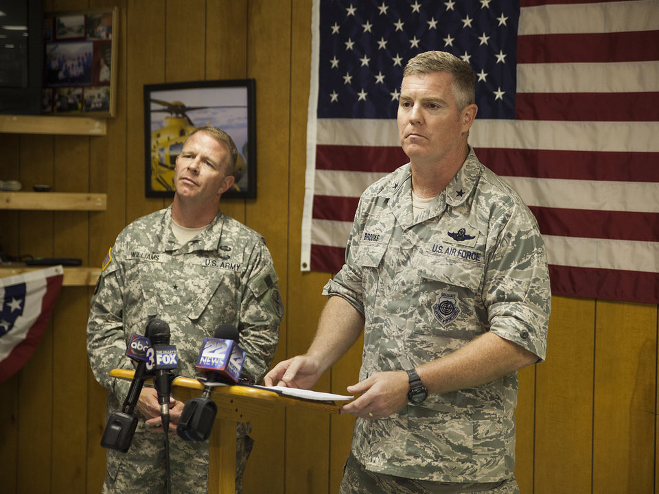 Photo - Brigadier General Timothy P. Williams, adjutant General of the Virginia National Guard, left, and Brigadier General Robert Brooks, component commander of the Massachusetts Air National Guard, answer questions from members of the media after announcing that the pilot who had been missing from an F-15 jet that crashed near Deerfield, Va. was found dead on Thursday, Aug. 28, 2014. (AP Photo/The Staunton News Leader, Griffin Moores)
