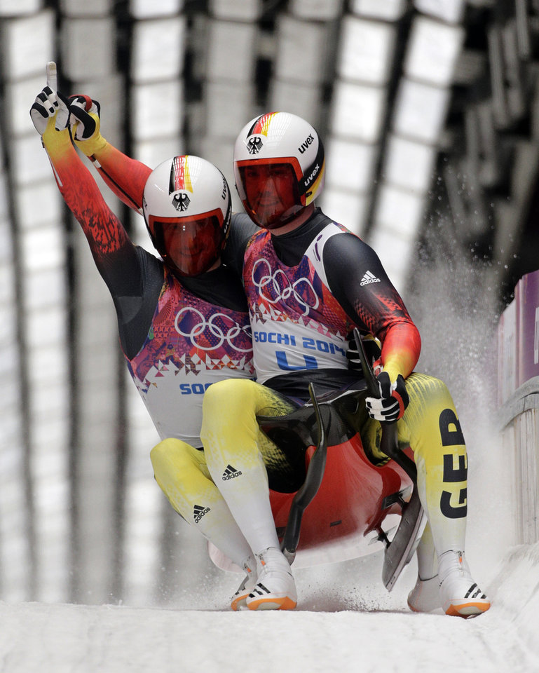Photo - The doubles team of Tobias Wendl and Tobias Arlt from Germany brake in the finish area after their final run to win the gold medal during the men's doubles luge at the 2014 Winter Olympics, Wednesday, Feb. 12, 2014, in Krasnaya Polyana, Russia. (AP Photo/Jae C. Hong)