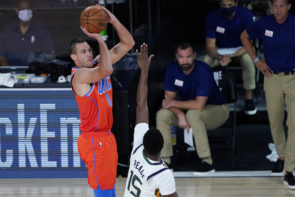 Photo - Aug 1, 2020; Lake Buena Vista, FL, USA; Oklahoma City Thunder's Danilo Gallinari (8) shoots over Utah Jazz's Emmanuel Mudiay (15) during the first half of an NBA basketball game Saturday, Aug. 1, 2020, in Lake Buena Vista, Fla. Mandatory Credit: Ashley Landis/Pool Photo via USA TODAY Sports