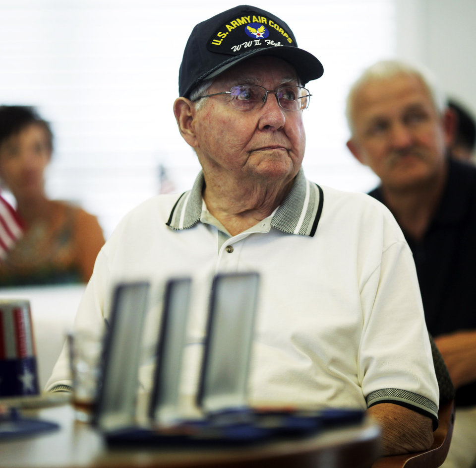 John Martin, a World War II veteran of the Army Air Force, received three medals for his service in World War II at his 90th birthday party on July 7, 2013. Photo by KT KING, The Oklahoman