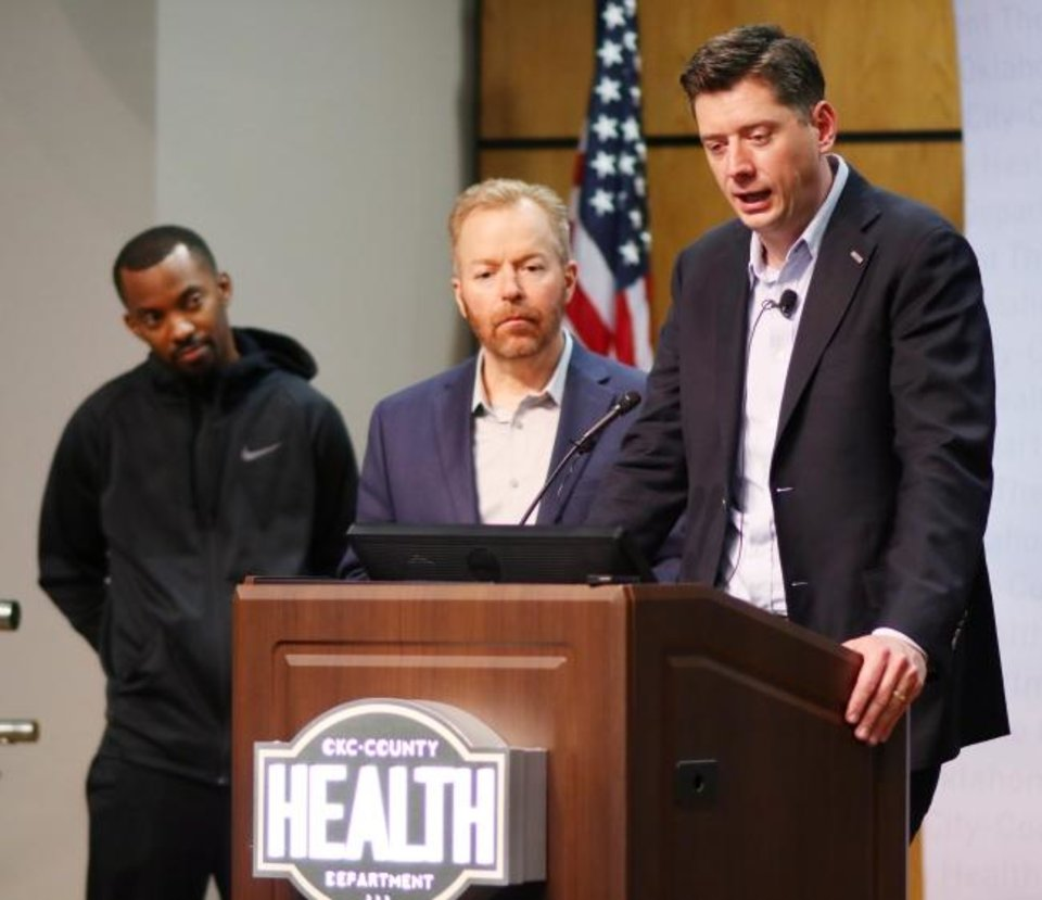 Photo -  Eddie Withers, Acute Disease Epidemiologist for OKC-County Health Dept., Dr. Patrick McGough, Executive Director of OKC-County Health Dept., and Oklahoma City Mayor David Holt talk about the declaration of a state of emergency Sunday for Oklahoma City.  [Doug Hoke/The Oklahoman]