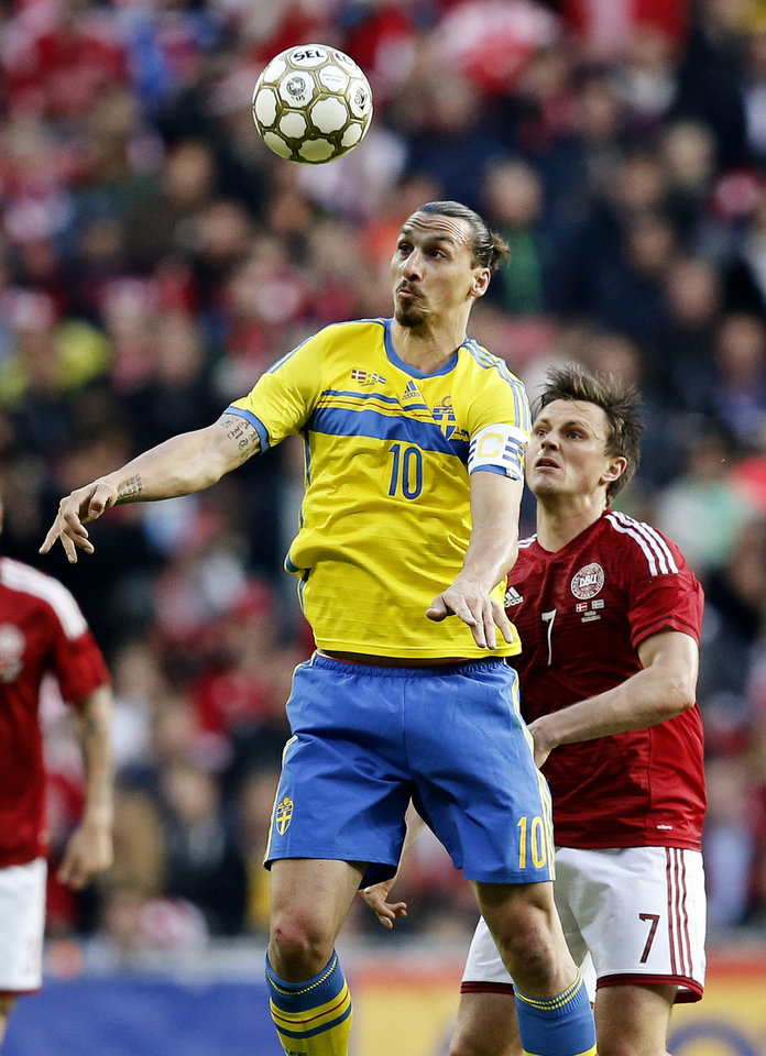 Photo - Sweden's  Zlatan Ibrahimovic, left,  and Denmark's William Kvist Jorgensen, compete for the ball during the friendly soccer match played in Copenhagen on Wednesday, May 28, 2014. (AP Photo/POLFOTO, Jens Dresling)  DENMARK OUT